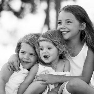 Three beautiful sisters, having fun outside.